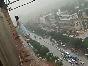 china woman jump from 18th floor saved by police