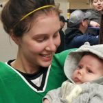 Hockey player breastfeeds her baby during game breaks - like a total mom bos