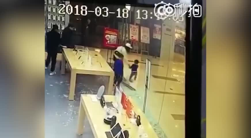 PHONE STORE'S GLASS DOOR 'EXPLODES IN TODDLER'S FACE' AS HE IS PULLING IT BACK AND FORTH